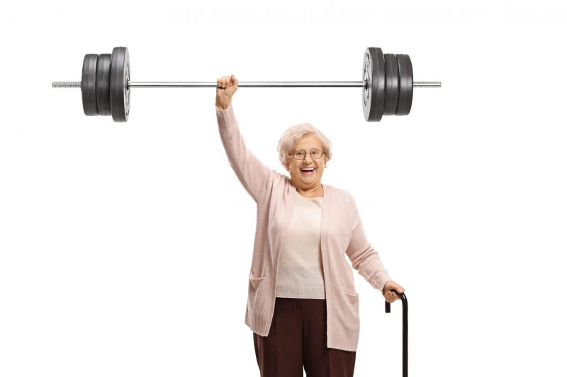Humorous photo of elderly lady lifting a heavy weight